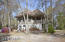 Located on an oversized wooded lot in Flood Zone X---high and dry!