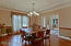ENTERTAIN WITH EASE IN THE FORMAL DINING ROOM WITH CHAIR RAILS & BRAZILIAN TEAK FLOORS. CLOSES OFF WITH POCKET DOORS