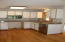 This house lends itself perfectly to a long wall kitchen with a grand island for the ultimate open floor plan