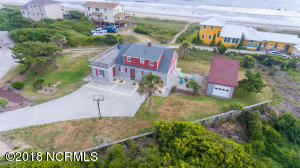 "Here's your chance to own a charming residence in Salter Path, considered ""almost oceanfront""! Rental income in the $30,000 range. Separate garage with unfinished room above. Lot is over 1/2 acre! Schedule your viewing today!"
