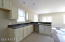 Open kitchen with granite tops and will feature stainless appliances