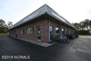 4 UNIT RETAIL BLDG INCLUDES 3 ADD'L VACANT LOTS