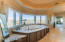 Luxurious travertine bathroom with a cupola ceiling
