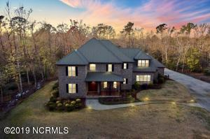 Welcome to 217 Steep Hill Drive. Five private acres, just four miles from the Emerald Isle bridge.