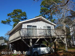 Coastal cottage on Oak Island is ideally located and designed as a beach getaway or year 'round home.