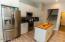 Kitchen with Butcher Block Island leading to 4th Bedroom/Bonus Room