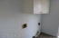 Laundry room off kitchen. Back door accesses brick patio.