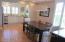 DINING ROOM OPEN, HARDWOOD FLOORS & SHUTTER WINDOW TREATMENTS