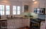 STAINLESS STEEL APPLIANCES WITH GRANITE COUNTERS, SHIPLAP CEILING & WALLS