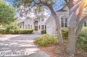 Stately brick home with beautiful live oak trees