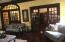Living Room- Beautiful Molding and Beveled Glass Doors