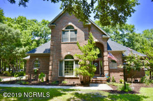 Stately brick home, 3BDR/2.5BA, is located within the exclusive gated community of Ocean Harbour Estates along the Intracoastal Waterway. The craftsmanship of this custom 2 story home is evident as soon as you enter the foyer.