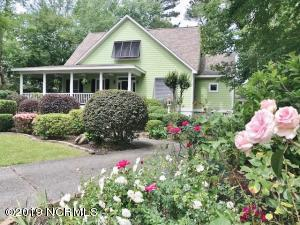 Great curb appeal & wonderful covered wrap around sitting porch! This is the Best Location in the neighborhood!