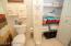 Large Linen closet in guest bath.