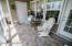 Spacioius screened porch with tile floor, relaxing here will be easy.