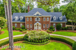 Stately and elegant, this home sits on beautifully landscaped lot.