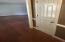To the left in front door is the living room