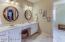 Dual sinks, lots of vanity space. 8'x7' walk-in closet!