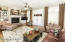 Great Room with rich hardwood flooring. Plantation shutters throughout