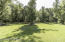 Large PRIVATE rear yard with wooded surround on 5.9 acres