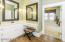 His and her cultured marble vanities with dressing area
