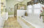Tile walk in shower and jetted whirlpool spa tub