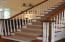 Beautiful carpeted stairway with an overlook into the great room