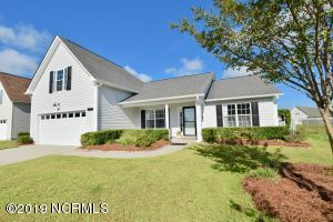 Low maintenance home with rocking chair front porch