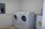 Large utility room with LG washer/dryer