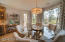 large dining area accented by wide picture glass window