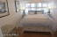 SECOND BEDROOM WITH HARDWOOD FLOORS SHIPLAP WALLS - FIRST FLOOR