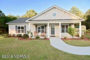 Low maintenance cottage with rocking chair front porch