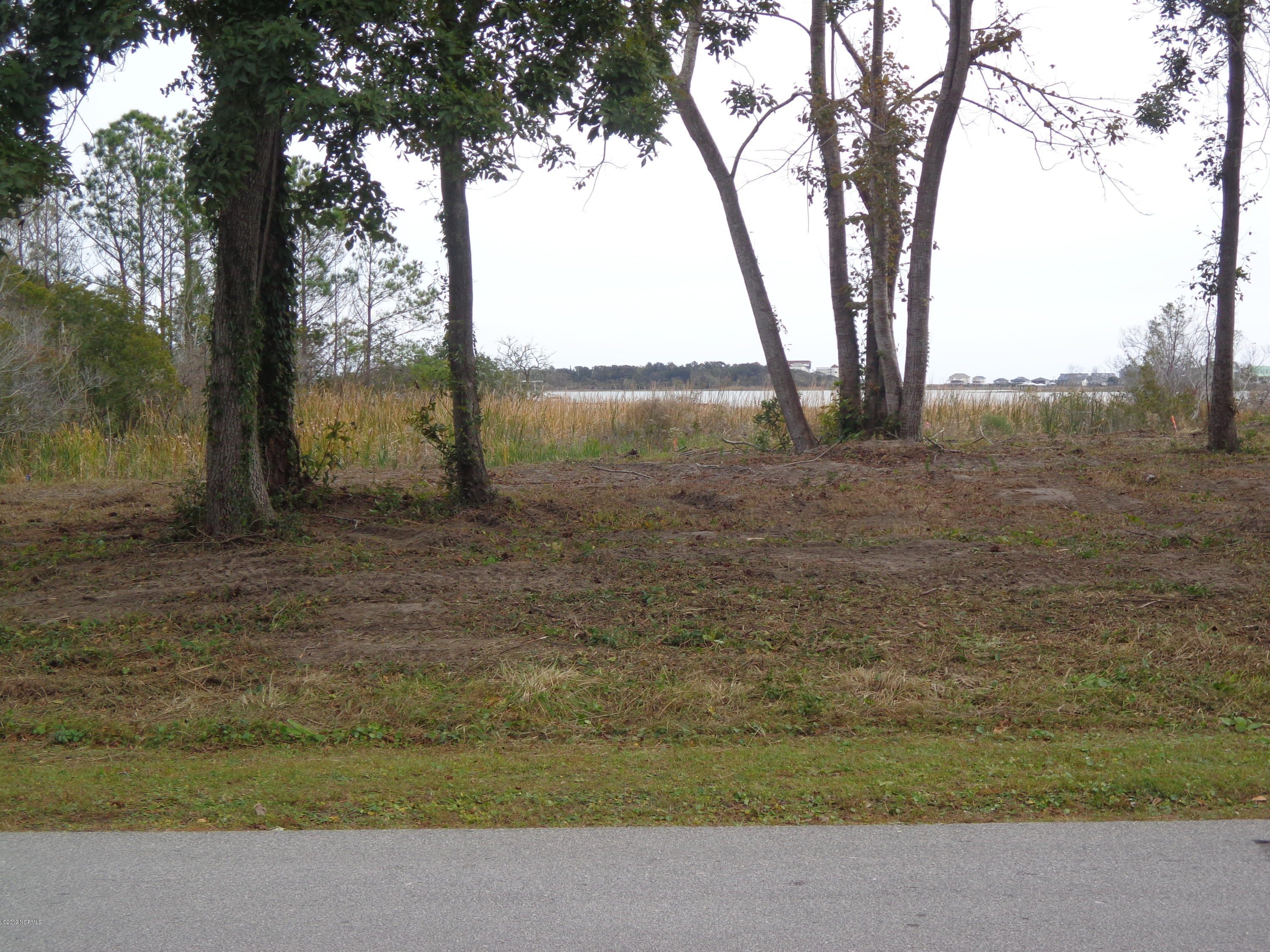 Waterfront building lot ( 1.59 Acres ) in Chadwick Shores , overlooking Chadwick Bay and the Intracoastal Waterway. Chadwick Shores is a private boating community. Well kept with a day dock , and picnic area by the water. It is also gated and landscaped in the gate area. Great place for fishermen , boaters,  and all water lovers.  Lot has been surveyed , wetland delineation defined, soil evaluation, and building envelope established.  Call for this information.