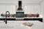 Quartz countertops, contrasting cabinets.