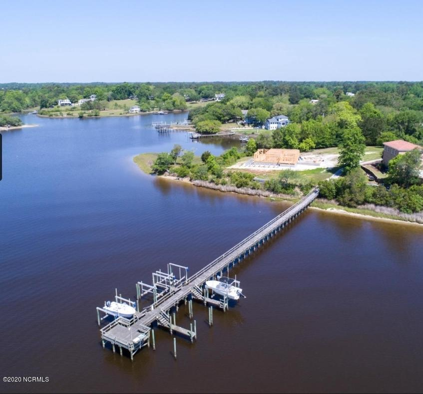RARE FIND and boater's delight - just reduced!Deeded boat slip included with this great corner ICW view building lot. Easy ocean and White Oak River access. New lighted dock, cleaning station, and seating to enjoy those beautiful sunrises and sunsets. Buy, boat, and even build later. A hidden treasure in this small quiet neighborhood - just minutes from quaint, downtown Swansboro.