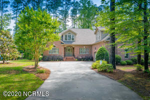 Located on a beautiful .69 acre golf and pond lot