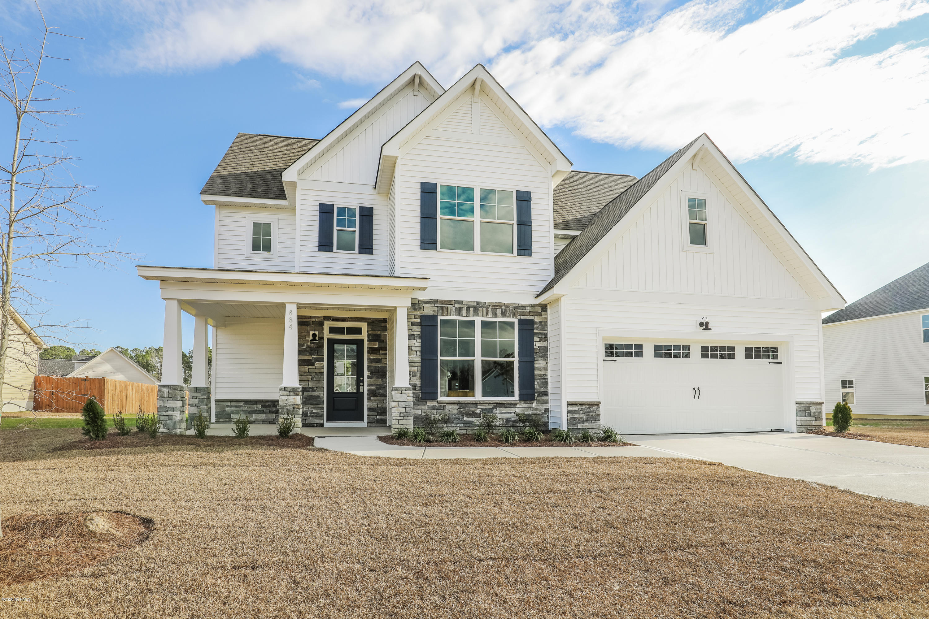Stunning pre sale Georgetown floor plan loaded with upgrades! Side load garage, covered rear porch, and so much more! 70 West Builders provides coastal craftsmanship in every build with stunning features!**all photos are of similar home in neighborhood**