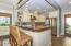 Kitchen Bar w/Stainless Steel Appliances - tile backsplash