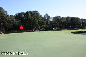 Gorgeous golf course lot overlooking the green and pond along side of fairway.