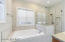 Enjoy soaking and relaxing in this master bath