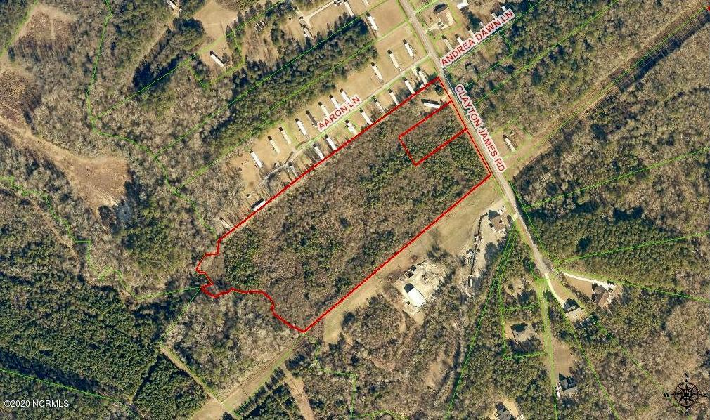 Offering two adjoining parcels for a total of 16.5 +/- acres.  Located on Clayton James Rd in rural Onslow County and just minutes from local military installations and all that Jacksonville has to offer.  This land offering is ideal for residential or recreational use or perhaps someone with horses.  Single wide on property will not convey.  Call for more information today!