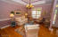 Open floor plan with tray ceiling