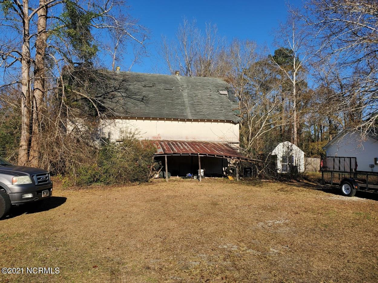 .37 Acre lot with Huge Barn which provides all kinds of opportunities. Lot is part of the subdivision but is not bound by the restrictive covenants. Call today for your VIP tour.