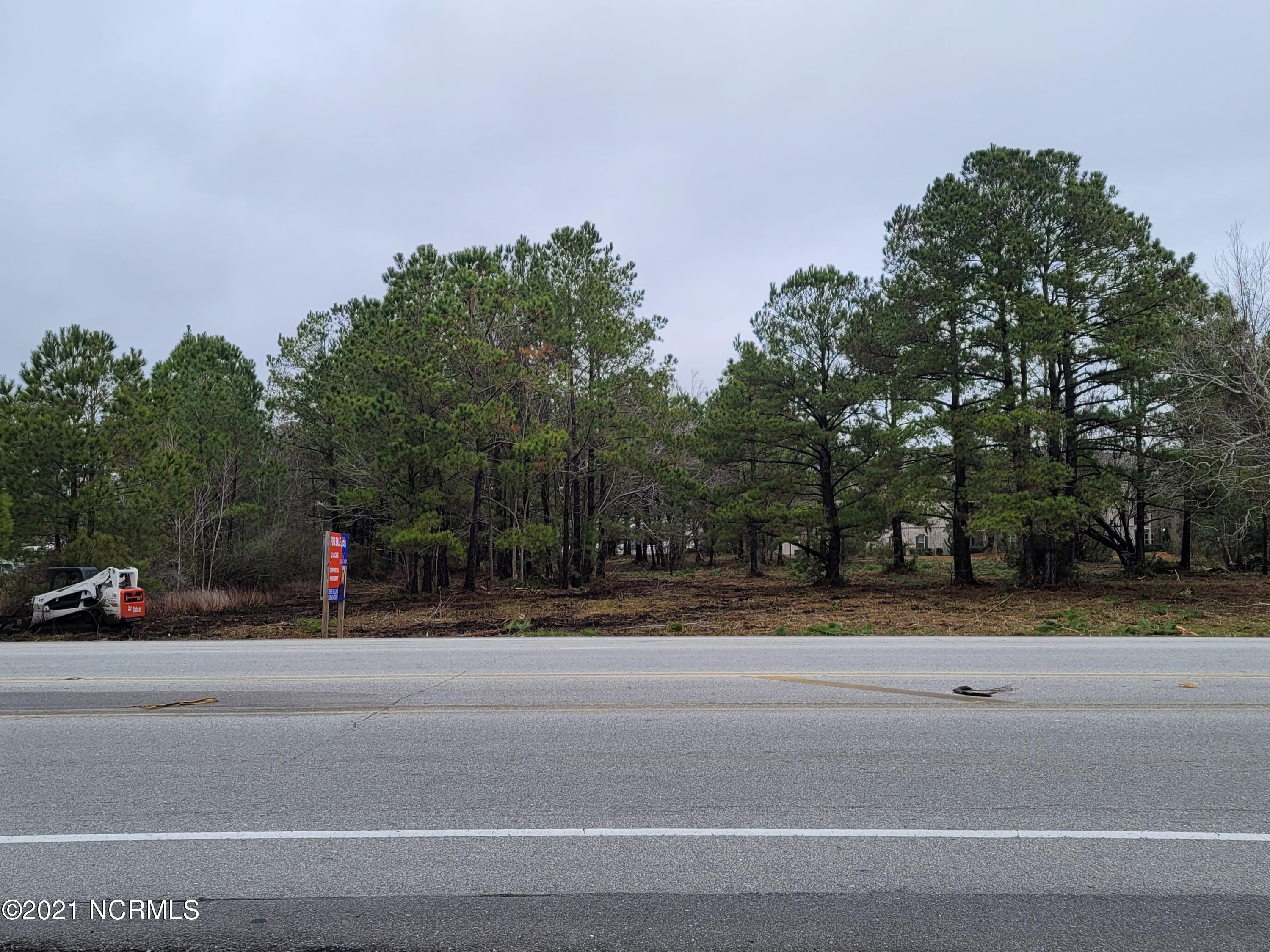 LOCATION, LOCATION, LOCATION!!!  PRIME COMMERCIAL located on HWY 210.  CLEARED OF ALL BRUSH/TREES THAT IS 6'' OR LESS IN DIAMETER.