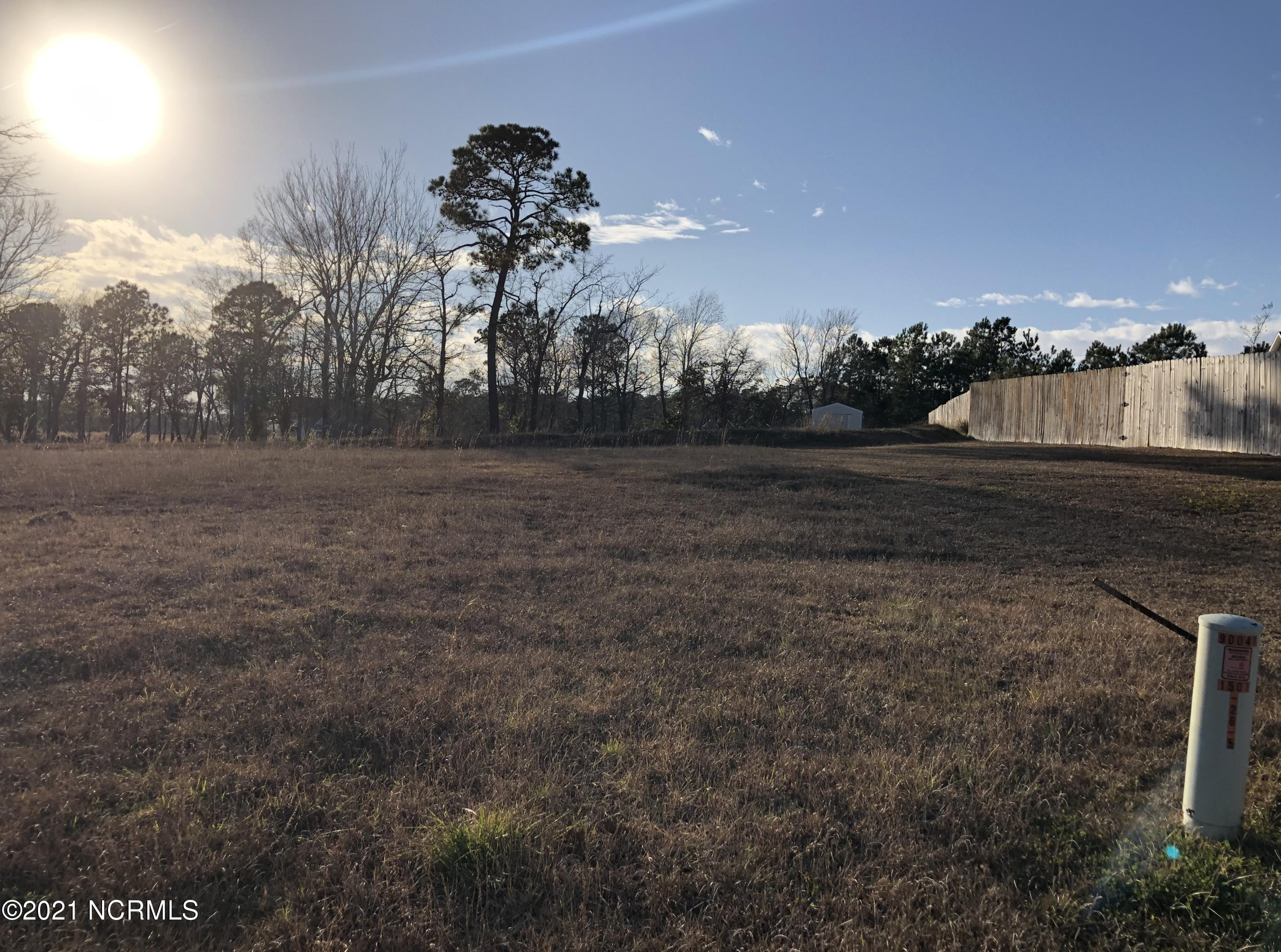 Two acre residential building lot for sale in Halls Creek North! Just minutes from historic Swansboro and the beach. Lot has frontage on the marsh and creek. Great for kayaks! Call for more information today!