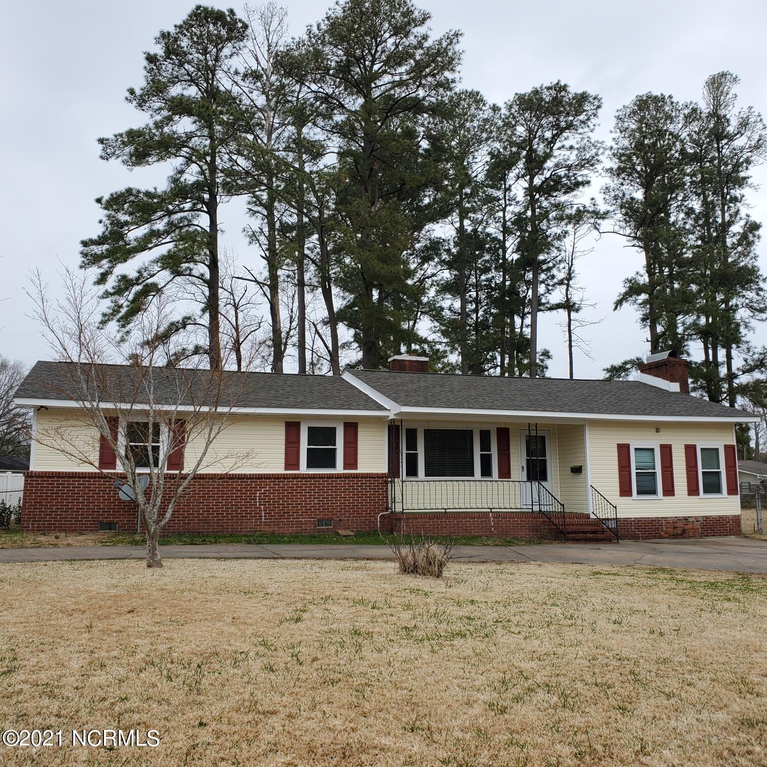 Charming home, includes new windows, roof, siding. Sunroom, 12x40. Original wood floors everywhere except kitchen, baths (tile) family room (new carpet) utility room.Three bedrooms, family room, living room, dining room adjoins family kitchen with nook. Utility room w/wet sink.  Old Republic Home Warranty  included.