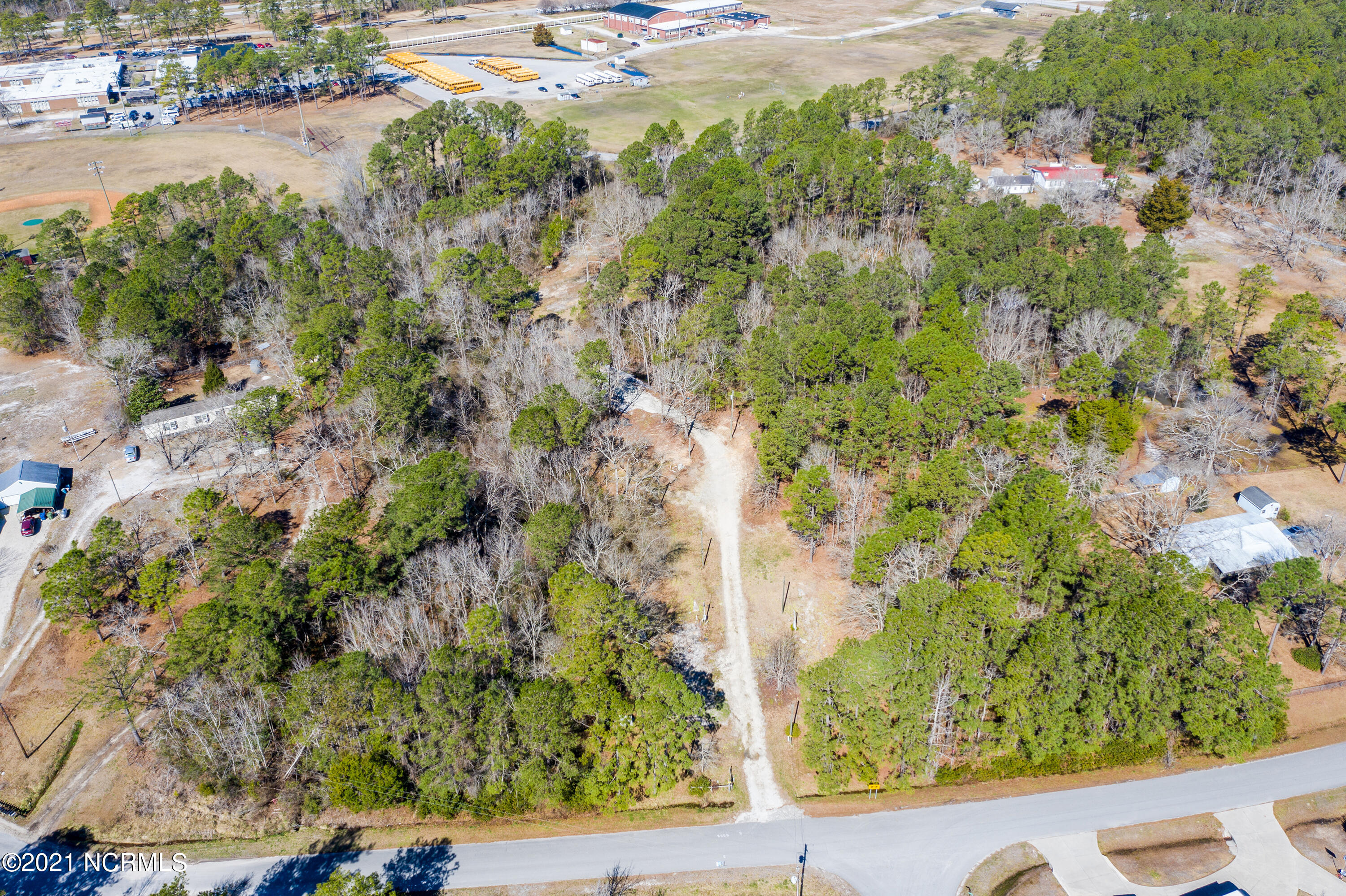 4.84 Acres situated on a quiet street right behind the Dixon High School.  Property has been cleared of old mobile homes and debris.  Septic permits uploaded and 5 water taps in place.