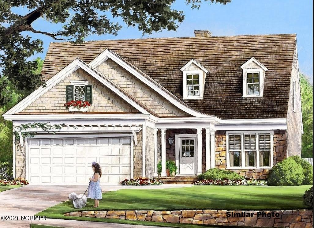 When you enter North Shore Country Club you are greeted by a beautiful green space with a golf course, ponds, and paved streets with golf carts strolling by! This neighborhood is so close to the water you can smell the ocean. When you walk up the driveway to the home you will enter through a covered porch with colonial white columns. Entering into the home through the foyer there is a formal dining area, kitchen, and living room with gas logs circling around a powder room for easy access. Off of the living room is the master bedroom, with an enormous walk in closet, next to the master bath that has a whirlpool tub and a walk in shower with dual vanity sinks.  Off to the side there is a laundry room tucked away that leads into the 2 car garage. Heading upstairs there is 2 bedrooms with a full bath that can be accessed from the larger upstairs bedroom or the hallway. The upstairs is finished off with a large storage area. Get yourself a golf membership with North Shore Country Club and bring your beach chairs, this is the perfect place to raise a family or retire! Only a minutes drive from Food Lion, CVS, a bagel shop, and a gym! You are home!!