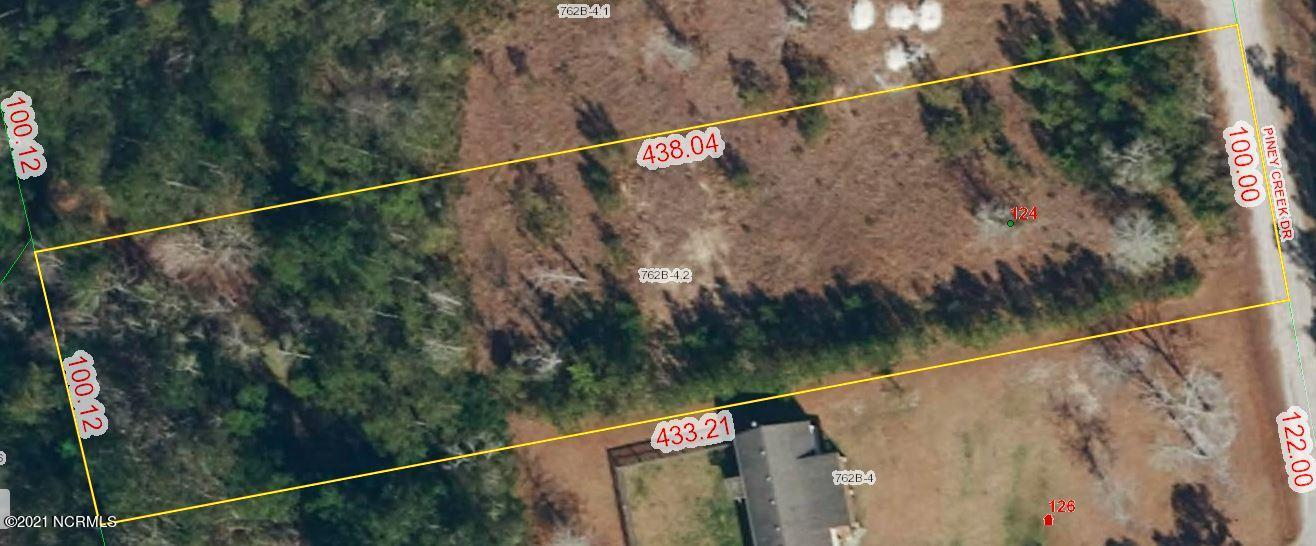 An acre lot located in a quiet country setting in between Holly Ridge and Sneads Ferry. There is an expired 3 bedroom septic permit on file.