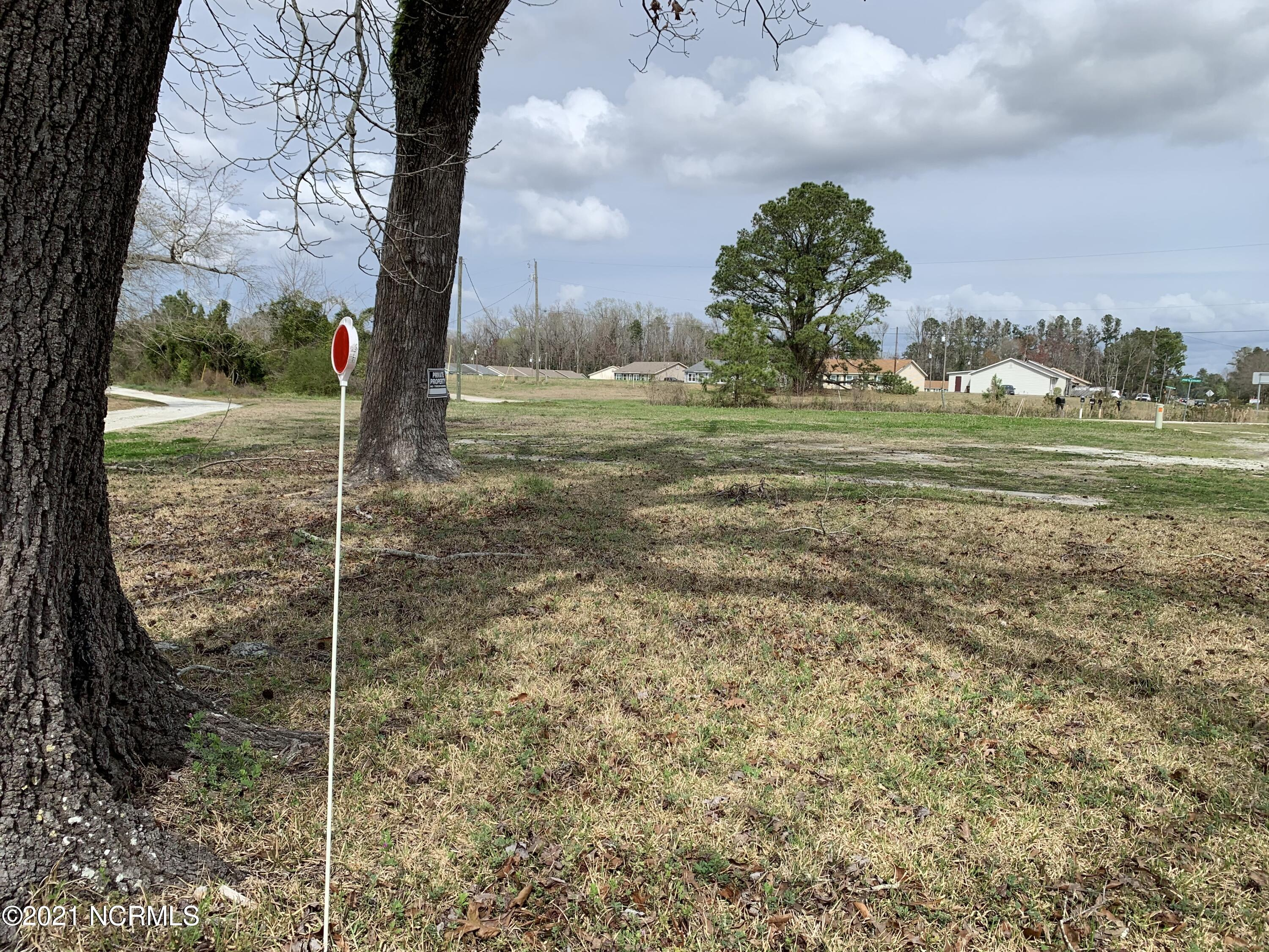 Prime Location, Many Possibilities!  Located only a few miles from the new bypass and across the street from Onslow Pines Road. The cleared lot is zoned RA and presents many possibilities for the new owner. The lot previously had 2 mobile homes on it and a small beauty shop. Septic Tanks already in place. Come check this one out before its gone!
